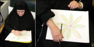 Sister Barbara McCarthy working on a sketch of a flower at the Truman Center.